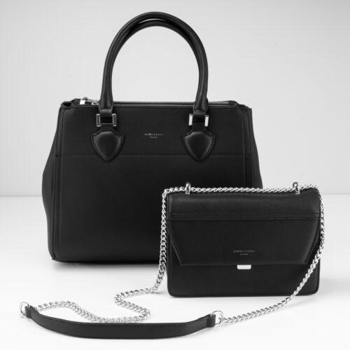 Zwei schwarze Fashion Bags von Trisa Accessoires, vor weissem Hintergrund.
